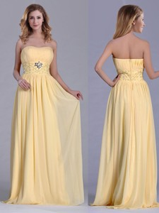 Lovely Empire Yellow Long Dama Dress With Beading And Ruching